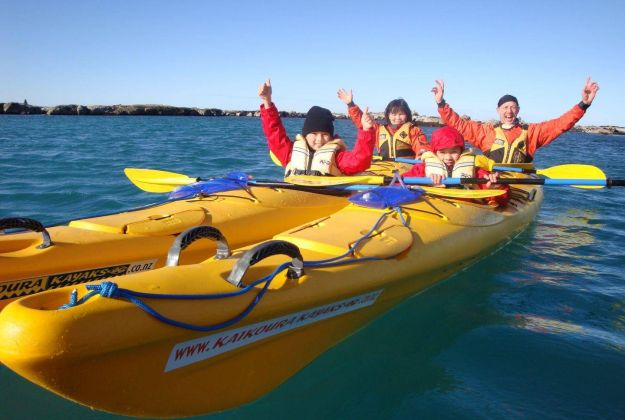 A young family kayaking off the coast of Kaikoura